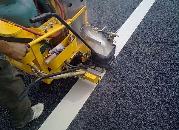 Adhesive road marking glass beads