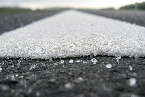 Adhesive road marking glass bead